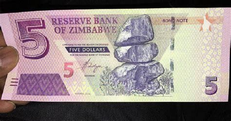 Zimbabwe introduces fresh $5 bond notes to ease cash