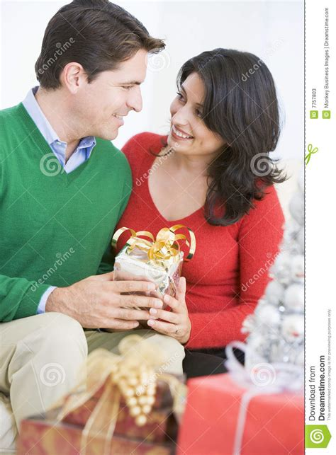 Husband Surprising Wife With Christmas Present Stock Image